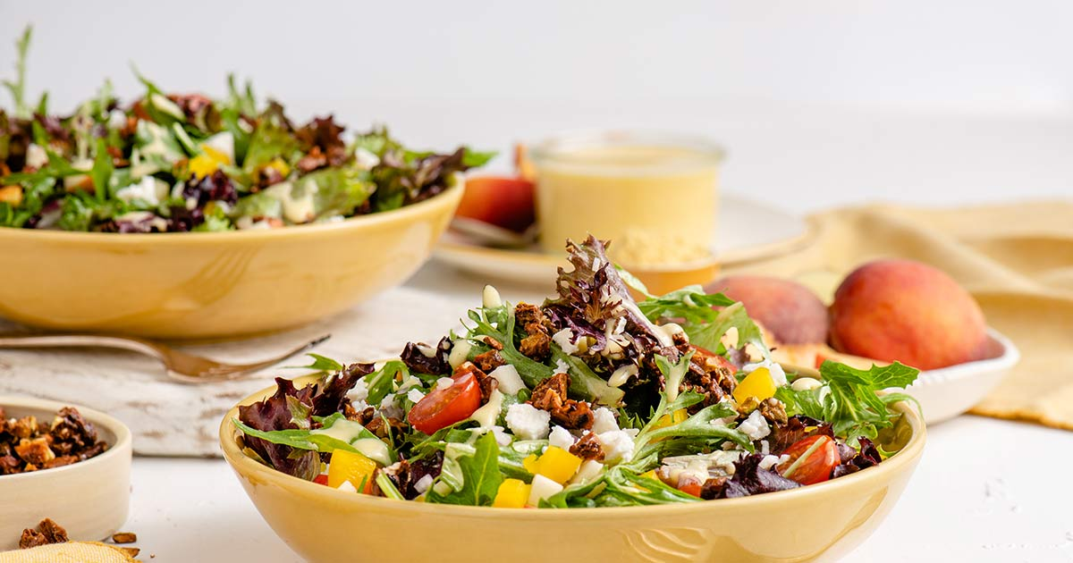 mixed-baby-greens-salad-peach-mustard-rum-vinaigrette