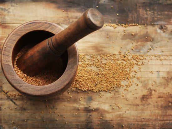 Grinding Mustard Seed with Mortar and Pestle