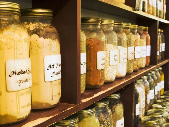 Mustard and spices stored in jars