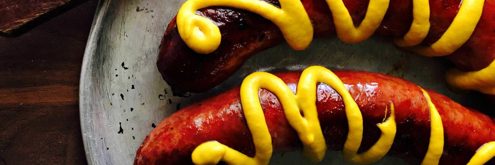 Mustard on sausages